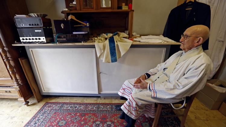 Father Jacques Clemens, 105, waits before holding a mass at St Benoit church in Nalinnes