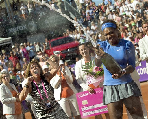 Serena Williams celebrates after winning her 53rd WTA title by beating Johanna Larsson in the final of the Swedish Open on Sunday, July 21, 2013 in Ba...
