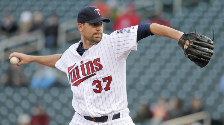Minnesota Twins starting pitcher Mike Pelfrey delivers during the first inning of a baseball game against the Toronto Blue Jays, the second of a doubleheader, Thursday, April 17, 2014, in Minneapolis. AP Photo/Paul Battaglia)