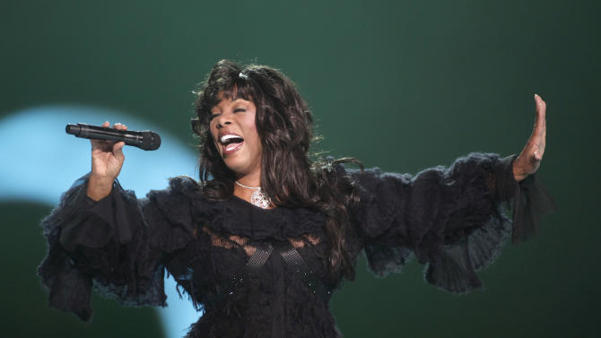 "FILE - This Dec. 11, 2009 file photo shows Donna Summer performing at the Nobel Peace concert in Oslo, Norway. The eclectic group of rockers Rush and Heart, rappers Public Enemy, songwriter Randy Newman, ""Queen of Disco"" Donna Summer and bluesman Albert King will be inducted into the Rock and Roll Hall of Fame next April in Los Angeles. The inductees were announced Tuesday by 2012 inductee Flea of The Red Hot Chili Peppers at a news conference in Los Angeles. (AP Photo/John McConnico, file)"