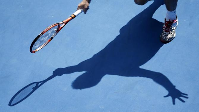 Stan Wawrinka of Switzerland casts a shadow on the court as he plays Guillermo Garcia-Lopez of Spain during their fourth round match at the Australian Open tennis championship in Melbourne, Australia, Monday, Jan. 26, 2015. (AP Photo/Vincent Thian )