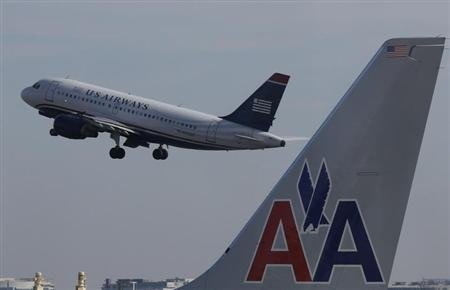 A U.S. Airways jet departs Washington&#39;s Reagan National Airport next to an American Airlines jet outside Washington, February 25, 2013. REUTERS/Larry Downing