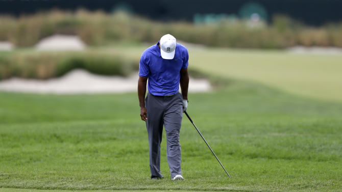 Tiger Woods reacts after a shot on the second hole during the first round of the U.S. Open golf tournament at Merion Golf Club, Thursday, June 13, 2013, in Ardmore, Pa. (AP Photo/Darron Cummings)