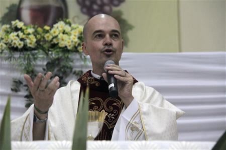Brazilian priest Roberto Fransisco Daniel attends mass at a church in Bauru, 330 km (205 miles) northwest of Sao Paulo, in this April 28, 2013 handout. REUTERS/Malavolta Jr/Jornal da Cidade/Handout