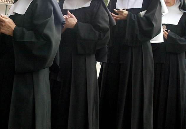 Nuns wait in line to vote on March 12, 2006 in Cali, Colombia. Three women dressed up as nuns were caught at a Colombian airport trying to smuggle cocaine taped to their bodies, police said Tuesday