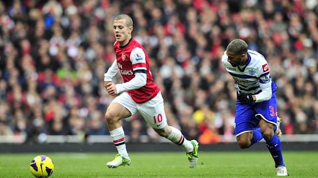 Arsenal's English midfielder Jack Wilshere (L) vies with Queens Park Rangers' French-born Senegalese defender Armand Traore