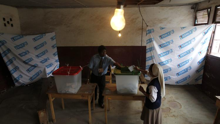 A nun casts her ballot at a polling centre in the capital Antananarivo