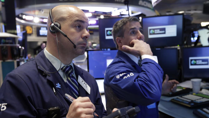 Trader Fred DeMarco, left, works on the floor of the New York Stock Exchange Tuesday, April 30, 2013. Stock prices are opening mostly lower on Wall Street as weak earnings from Pfizer and other companies drag down major market averages. (AP Photo/Richard Drew)