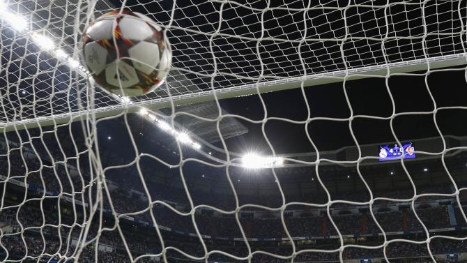 Real Madrid's goalkeeper Casillas lies on the pitch after conceding a goal scored by Basel's Gonzalez during their Champions League soccer match at Santiago Bernabeu stadium in Madrid