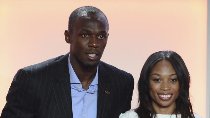 Jamaican athlete Usain Bolt and US sprinter Allyson Felix pose for photographs with their trophies during the IAAF´s Athlete of the Year Award marking its centenary in Barcelona, Saturday, Nov. 24, 2012.  (AP Photo/Manu Fernandez)