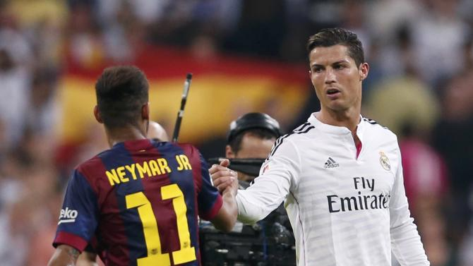 """Real Madrid's Ronaldo greets Barcelona's Neymar after their Spanish first division """"Clasico"""" soccer match at the Santiago Bernabeu stadium in Madrid"""