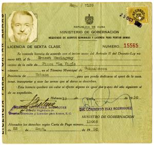 This photo released Tuesday, Feb. 11, 2014 by the John F. Kennedy Presidential Library and Museum in Boston, shows Ernest Hemingway's 1950 license to carry arms in Cuba, one of many new items from his former Cuban estate being made available at the museum. To date, the Kennedy Library has the world's largest collection of Hemingway's life and work, containing most of his manuscript material. (AP Photo/John F. Kennedy Library and Museum) NO SALES.