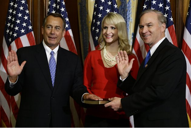 House Speaker John Boehner of Ohio performs a mock swearing in for Rep. Randy Forbes. R-Va., Thursday, Jan. 3, 2013, on Capitol Hill in Washington, as the 113th Congress began. (AP Photo/Charles Dhara