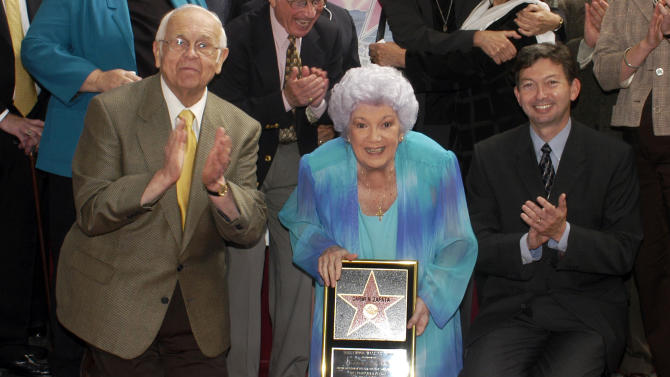 """In this Oct. 2, 2003 photo provided by the Hollywood Chamber of Commerce, actress Carmen Zapata poses with honorary Hollywood mayor Johnny Grant, left, and chamber president Leron Gubler, right, as she receives her star on the Hollywood Walk of Fame in Los Angeles. Zapata died Sunday, Jan. 5, 2014, at her Los Angeles home, surrounded by family and friends. She was 86. Her death was announced Tuesday, Jan. 7, by Luis Vela at the Bilingual Foundation of the Arts, a Los Angeles organization that Zapata founded. Zapata started her career in 1945 in the Broadway musical """"Oklahoma"""" and went on to perform in """"Bells Are Ringing,"""" """"Guys and Dolls"""" and many plays. Her movie credits include """"Sister Act,"""" """"Gang Boys"""" and """"Carola,"""" as well as dozens of television series. (AP Photo/Hollywood Chamber of Commerce, Bob Freeman)"""