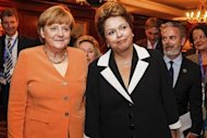 Brazil's President Dilma Rousseff (R) and German Chancellor Angela Merkel pose during a meeting at Santiago, in this photo provided by the Brazilian Presidency January 26, 2013. REUTERS/Roberto Stuckert Filho/Brazil Presidency Handout