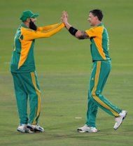 PRETORIA, SOUTH AFRICA - OCTOBER 19: Dale Steyn and Hashim Amla of South Africa celebrate the wicket of Ricky Ponting of Australia during the 1st One Day International between South Africa and Australia at SuperSport Park, Centurion on October 19, 2011 in Pretoria, South Africa. (Photo by Lee Warren/Gallo Images/Getty Images)
