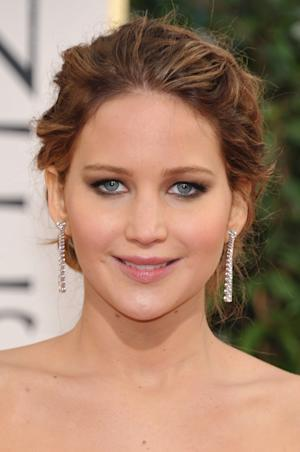 Actress Jennifer Lawrence arrives at the 70th Annual Golden Globe Awards at the Beverly Hilton Hotel on Sunday Jan. 13, 2013, in Beverly Hills, Calif. (Photo by John Shearer/Invision/AP)
