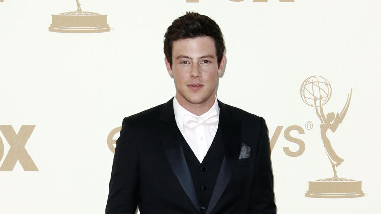 """FILE - In this Sept. 18, 2011 file photo, Cory Monteith arrives at the 63rd Primetime Emmy Awards, in Los Angeles. """"Glee"""" launched its new season Thursday, Sept. 26, 2013, with the first episode of a two-part Beatles tribute. Lea Michele's character, Rachel, looks at a cell phone photo that includes a group shot with Monteith's character, Finn, in it. She sings the Beatles' """"Yesterday"""" in the scene. (AP Photo/Matt Sayles, File)"""