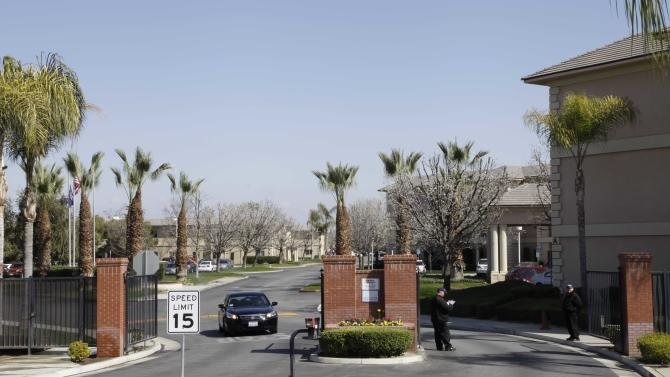 """A car passes through the gate of Glenwood Gardens in Bakersfield, Calif., Monday March 4, 2013, where an elderly woman died after a nurse refused to perform CPR on her last week. The central California retirement home is defending one of its nurses who refused pleas by a 911 operator to perform CPR on an elderly woman, who later died. """"Is there anybody that's willing to help this lady and not let her die,"""" dispatcher Tracey Halvorson says on a 911 tape released by the Bakersfield Fire Department aired by several media outlets. (AP Photo/Gosia Wozniacka)"""