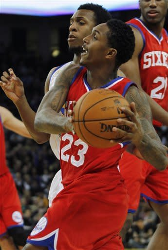 76ers overcome slow start, roll past Warriors