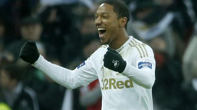 Swansea City&#39;s Jonathan de Guzman celebrates after scoring a penalty during their English League Cup final soccer match against Bradford City at Wembley Stadium (Reuters)