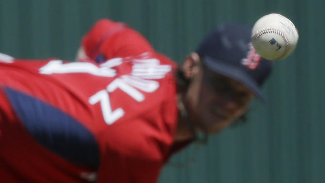Boston Red Sox starting pitcher Clay Buchholz delivers against the Minnesota Twins in the first inning during an exhibition spring training baseball game, Wednesday, April 1, 2015, in Fort Myers, Fla. (AP Photo/Brynn Anderson)