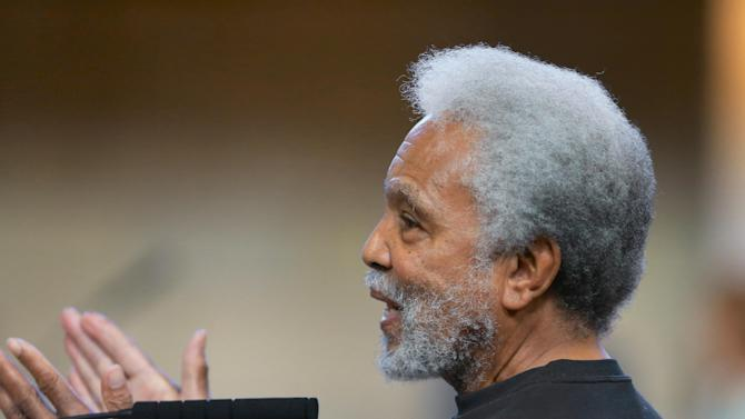 """Neb. State Sen. Ernie Chambers of Omaha speaks during debate in the Legislative Chamber in Lincoln, Neb., Monday, March 30, 2015. Chambers' comment comparing police to the Islamic State terrorist group came up again on Monday and filled up most of the Legislature's morning debate time. Earlier this month, Chambers said """"my ISIS is the police"""" because officers are licensed to kill and pose a threat to his neighborhood. Chambers said he isn't a man of violence, but if he carried a gun, he would use it as protection against police and would want to shoot first and ask questions later. (AP Photo/Nati Harnik)"""