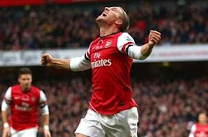 Arsenal star Podolski: Wenger is a super coach