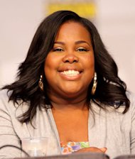 Amber Riley is showing off a new figure!