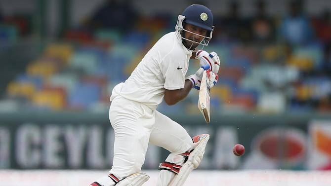 India's Pujara plays a shot during the first day of their third and final test cricket match against Sri Lanka in Colombo
