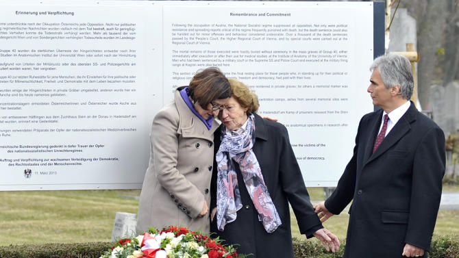 """Interior Minister Johanna Mikl-Leitner, Resistance fighter Katharina Sasso and Austrian Chancellor Werner Faymann, from left, attend the unveiling of a plaque honoring the thousands of Austrians killed by the Nazis for opposing them, before and after the so-called """"Anschluss"""" at the Central Cemetary in Vienna, Austria, Monday, March 11, 2013. Austria's chancellor has urged fellow Austrians to strive to prevent a return of the political climate that allowed Nazi atrocities, in comments marking Germany's annexation of Austria 75 years ago. (AP Photo/Hans Punz)"""