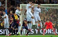 Barcelona's Argentinian forward Lionel Messi (10) performs a free-kick during the Spanish Supercup football match against Real Madrid CF on August 23, 2012 at the Camp Nou stadium in Barcelona. Barcelona defeated Real Madrid 3-2