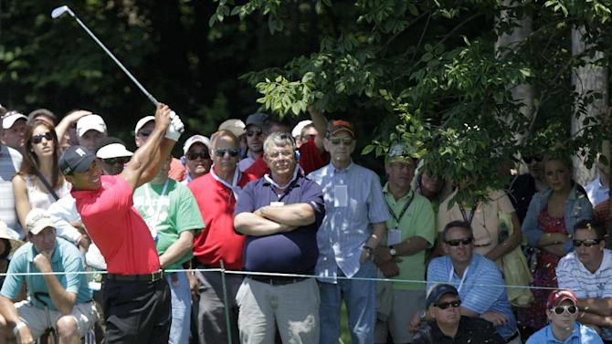 Tiger Woods watches his second shot on the first hole during the final round of the Memorial golf tournament on Sunday, June 3, 2012, in Dublin, Ohio. Woods parred the hole. (AP Photo/Jay LaPrete)