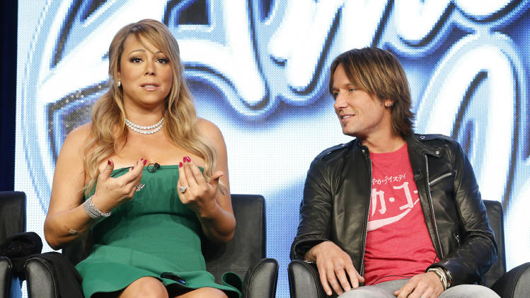 "Mariah Carey and Keith Urban from ""American Idol"" attend the Fox Winter TCA Tour at the Langham Huntington Hotel on Tuesday, Jan. 8, 2013, in Pasadena, Calif. (Photo by Todd Williamson/Invision/AP)"
