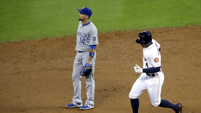 Houston Astros' George Springer (4) rounds the bases as Kansas City Royals second baseman Omar Infante (14) looks to the outfield on a two-run homer in the third inning of a baseball game Tuesday, June 30, 2015, in Houston. (AP Photo/Pat Sullivan)