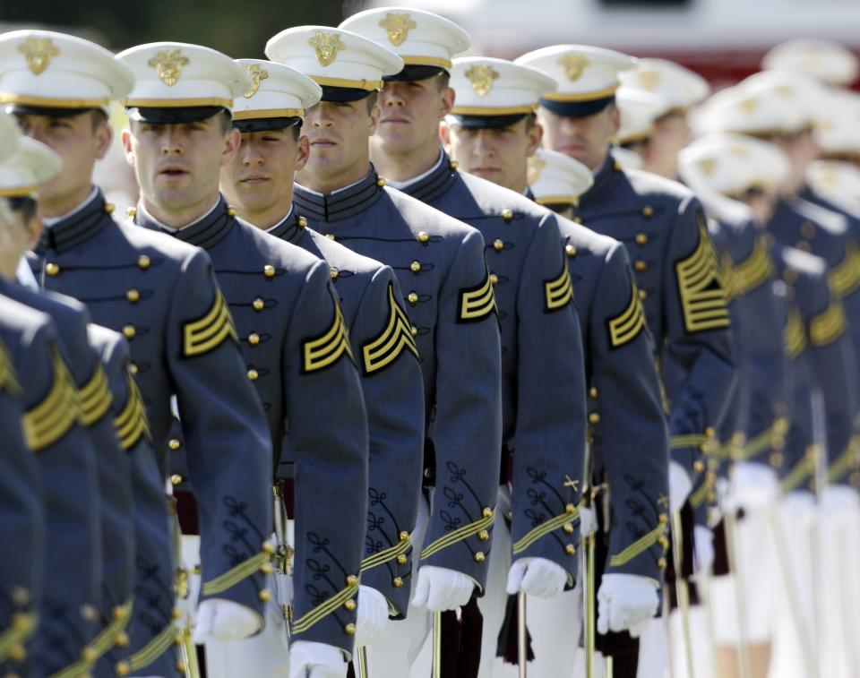 Cadets march into Michie Stadium during a graduation and commissioning ceremony at the U.S. Military Academy in West Point, N.Y., on Saturday, May 21, 2011.   (AP Photo/Mike Groll, Pool)