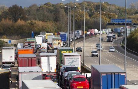 A car drives clockwise along the M25, as anti-clockwise traffic is at a standstill after heavy rain and road works caused a 20 mile jam on London's orbital motorway