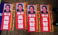 Placards featuring the photograph of jailed Chinese human rights lawyer Gao Zhisheng are pictured during a 2011 protest in Hong Kong. US officials and lawmakers took aim at China Wednesday, saying human rights were deteriorating in the communist-run nation as Chinese leaders move to quash even the slightest sign of dissent