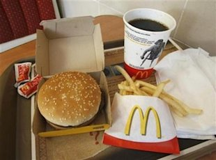 A meal consisting of a Quarter Pounder hamburger, french fries and soft-drink is pictured at a McDonald's restaurant in Los Angeles, California July 23, 2008.