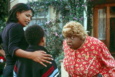 Nia Long and her son meet her aunt, a crass Southern granny known as Big Momma ( Martin Lawrence ) in 20th Century Fox's Big Momma's House