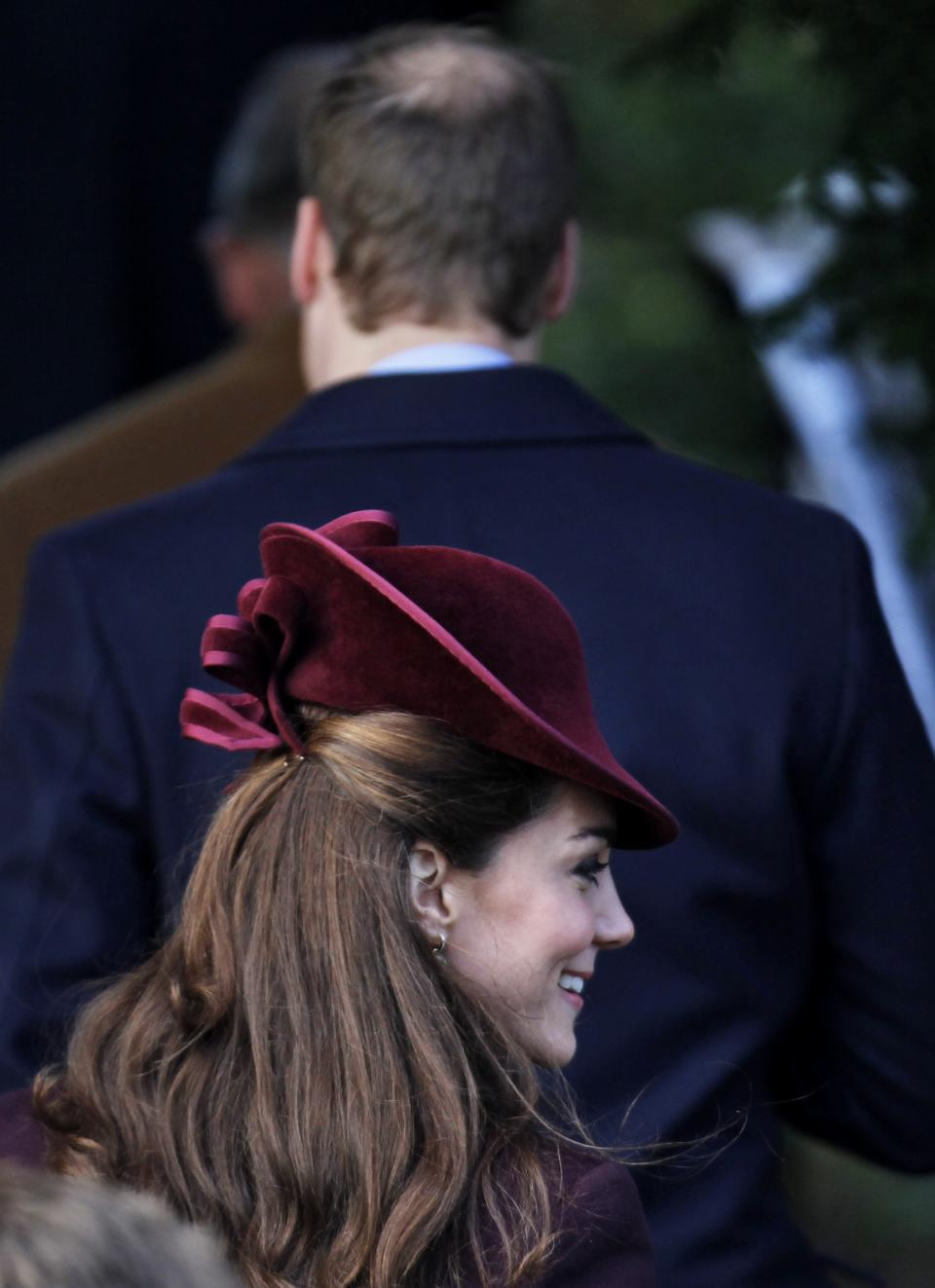 Kate, Duchess of Cambridge, follows her husband Prince William, as they arrive arrive to attend a Christmas Service with other members of the royal family at St. Mary's church in the grounds of Sandringham Estate, the Queen's Norfolk retreat, England, Sunday, Dec. 25, 2011. (AP Photo/Lefteris Pitarakis)