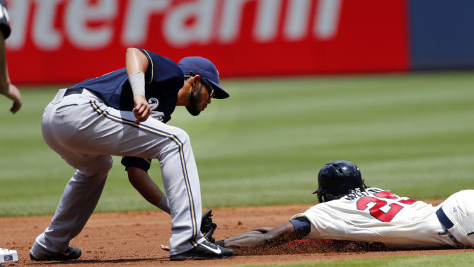 Atlanta Braves' Cameron Maybin (25) is tagged out at second base by Milwaukee Brewers shortstop Luis Sardinas while attempting to steal in the first inning of a baseball game Sunday, May 24, 2015, in Atlanta. (AP Photo/John Bazemore)