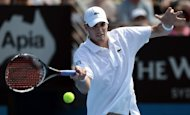 American John Isner returns a shot against compatriot Ryan Harrison at the Sydney International on January 9, 2013. The world number 13 Isner has withdrawn from next week&#39;s Australian Open with a knee injury, tournament organisers said on Thursday