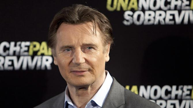 "FILE - In this March 24, 2015 file photo, actor Liam Neeson poses for photographers during the presentation of the film ""Run All Night"" in Madrid. Ad executives looking for a celebrity to endorse their product can't do much better than Neeson, according to the Nielsen Company's first ""N-Scores,"" released Tuesday, May 26, 2015. (AP Photo/Abraham Caro Marin, File)"