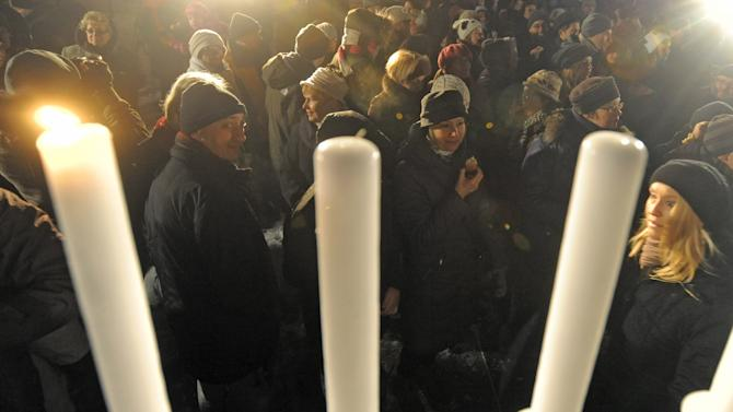 People gather to watch the lightning of the first candle, celebrating the beginning of Hanukkah, the Jewish festival of lights, on Grzybowski square in Warsaw, Poland, Saturday, Dec. 8, 2012. (AP Photo/Alik Keplicz)