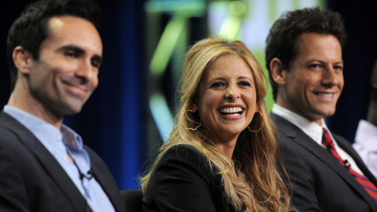 "Nestor Carbonell, left, Sarah Michelle Gellar, center, and Ioan Gruffudd, cast members in the CW television series ""Ringer,"" take part in a panel discussion on the show at the CW Showtime summer press tour in Beverly Hills, Calif., Thursday, Aug. 4, 2011. (AP Photo/Chris Pizzello)"