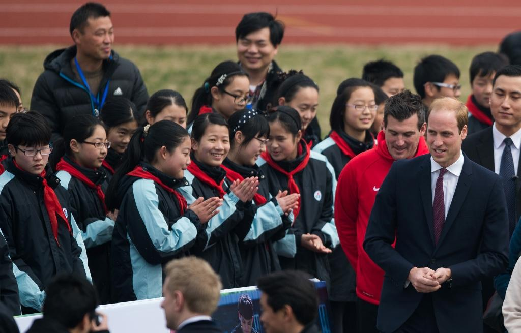 Prince William tries out football diplomacy in China