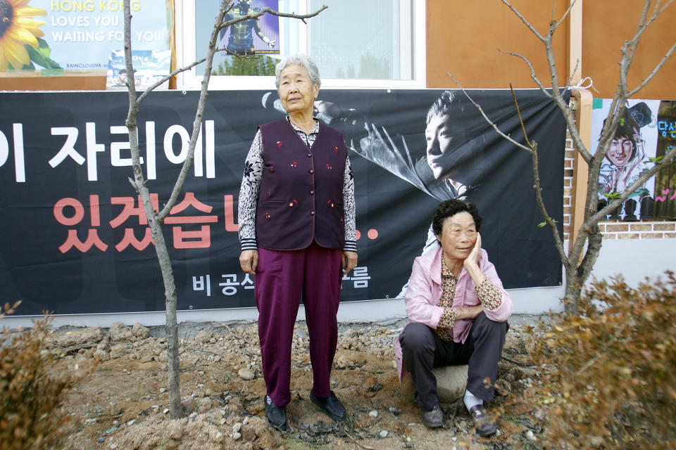 Local elderly women wait for South Korean pop singer Rain before the 29-year-old singer enters the army to serve in front of an army training center in Uijeongbu, north of of Seoul, South Korea, Tuesday, Oct. 11, 2011. (AP Photo/ Lee Jin-man)