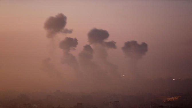 Smoke rises in the skyline from Israeli strikes in eastern Gaza City, early Wednesday, July 30, 2014, amid Israel's heaviest air and artillery assault in more than three weeks of Israel-Hamas fighting. (AP Photo/Khalil Hamra)