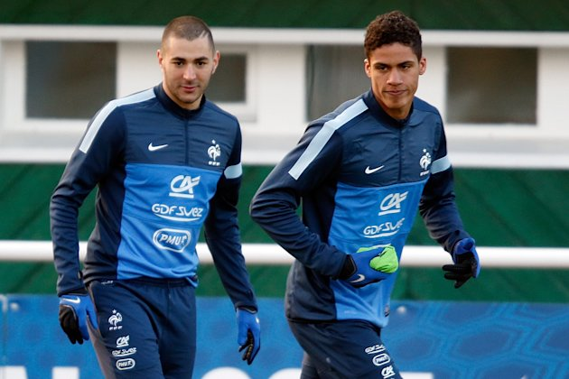 France's national soccer team players Benzema and Varane attend a training session in Clairefontaine, near Paris